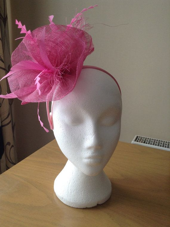 Beautiful Pale Pink Fascinator made with sinamay waves. With Chevron Feathers. This fascinator is on a band. Chic and elegant. A stunning