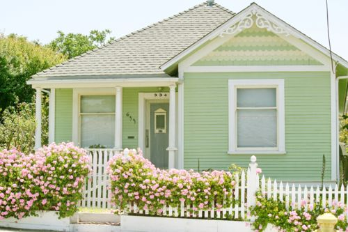 Sweet little mint coloured cottage - lovely with pink flowers and white picket fence and white trims.