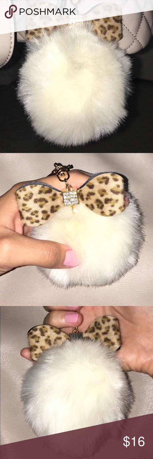 Puff Ball Keychain New and cute puff ball keychain with gold and diamonds with a leopard design. Accessories Key & Card Holders