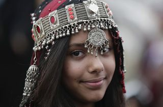 A Yemeni girl wearing traditional costume