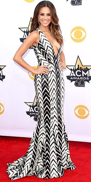 The Biggest, Best and Boldest Gowns of the Night | JANA KRAMER   | She's recently engaged, but we're not getting any bridal vibes from her thoroughly fashion-forward, graphic black-and-white gown with a plunging neckline and accompanying messy waves.