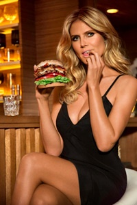 """Supermodel Heidi Klum updates the """"Mrs. Robinson"""" role in the Hardee's and Carl's Jr. ad for the Jim Beam Bourbon Burger."""