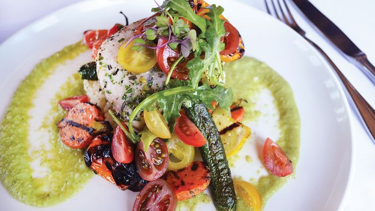 Chef Tom Lyons of Best of Award of Excellence-winning 22 Bowen's Wine Bar and Grill says that when it comes to summer in Newport, Rhode Island, it's all about the seafood. He shares a recipe for striped bass with summer vegetables, basil couscous and green tomato gazpacho sauce. Plus, Wine Spectator recommends 14 Chardonnays from Burgundy to try alongside the dish.