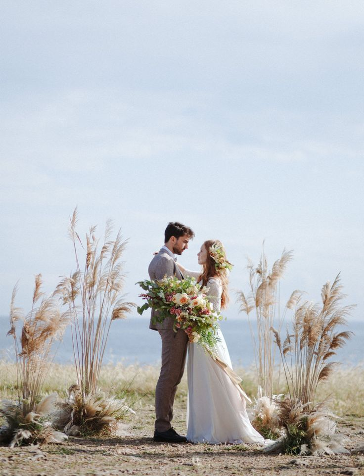 Modern Romance in Apulia // Puglia, Italy ceremony space framed by grass // wild bohemian elegant elopement inspiration