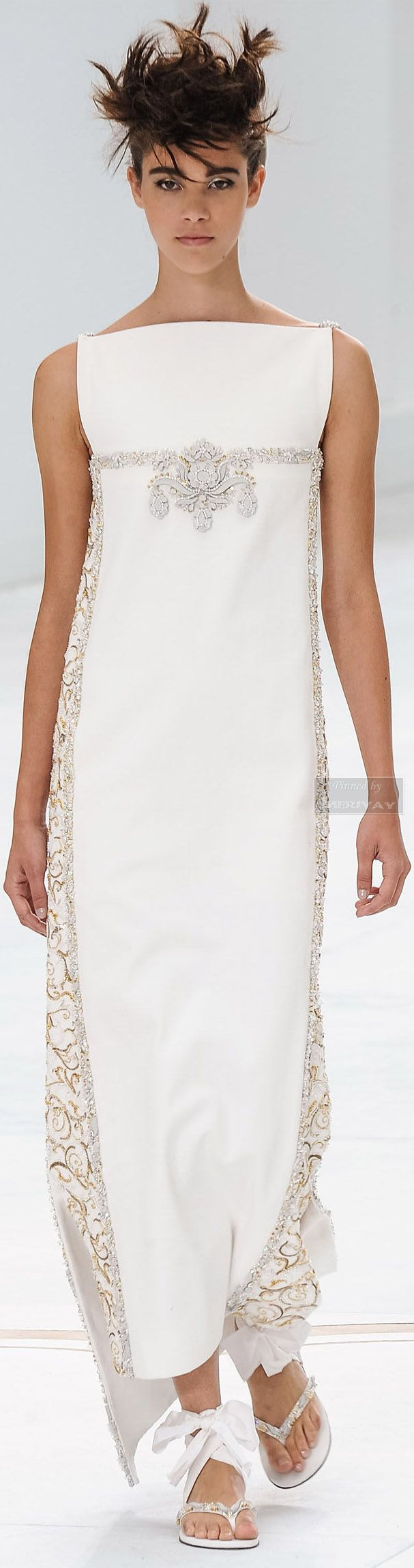 Chanel. One can't see the shoulders very well but they are jeweled/embroidered. #white