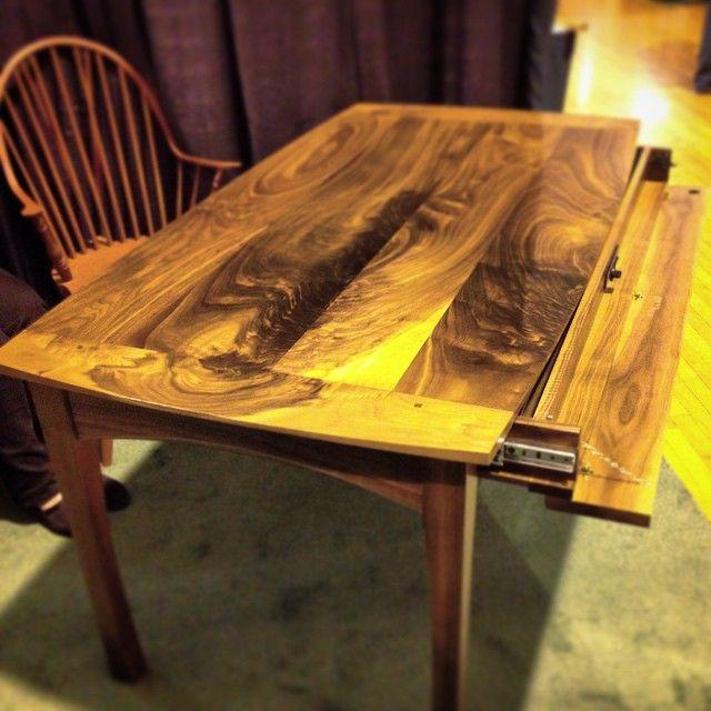 curly walnut dining table showing off its secret storage compartment #secretstoragefurniture #secretcompartment #finefurniture #madeinnewhampshire #customwoodwork #diningtable #diningtabledesign