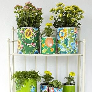 Paint cans covered with oilcloth