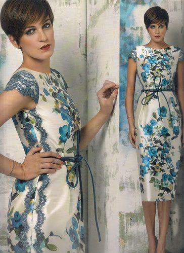 Vestido ceremonia colección Rose Cotillard de Nacho Bueno, en tejido mikado fondo nacarado, estampado flores azules