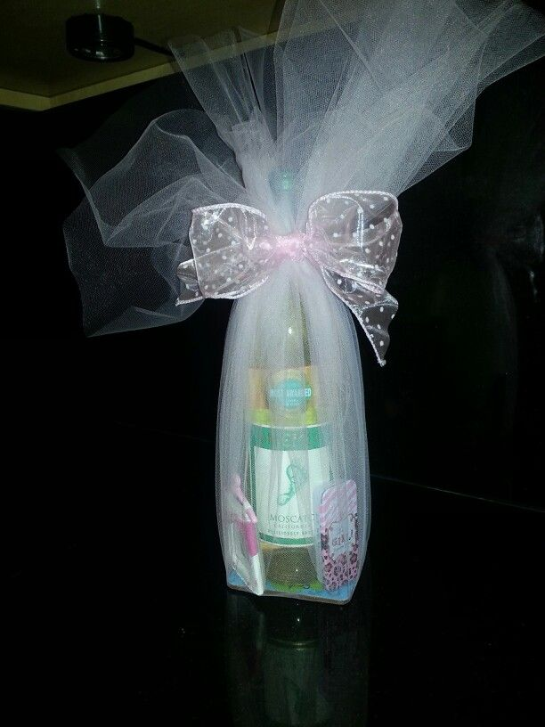 Game prize for a baby shower. . Barefoot Wine (it has a footprint on it that looks like a baby's) sitting on a coaster that has a fun saying in it for a busy mom,  it's a girl mints, chocolate bar and mini picture frame that says thanks for hanging out. Wrapped in tulle and a bow.  Awesome!
