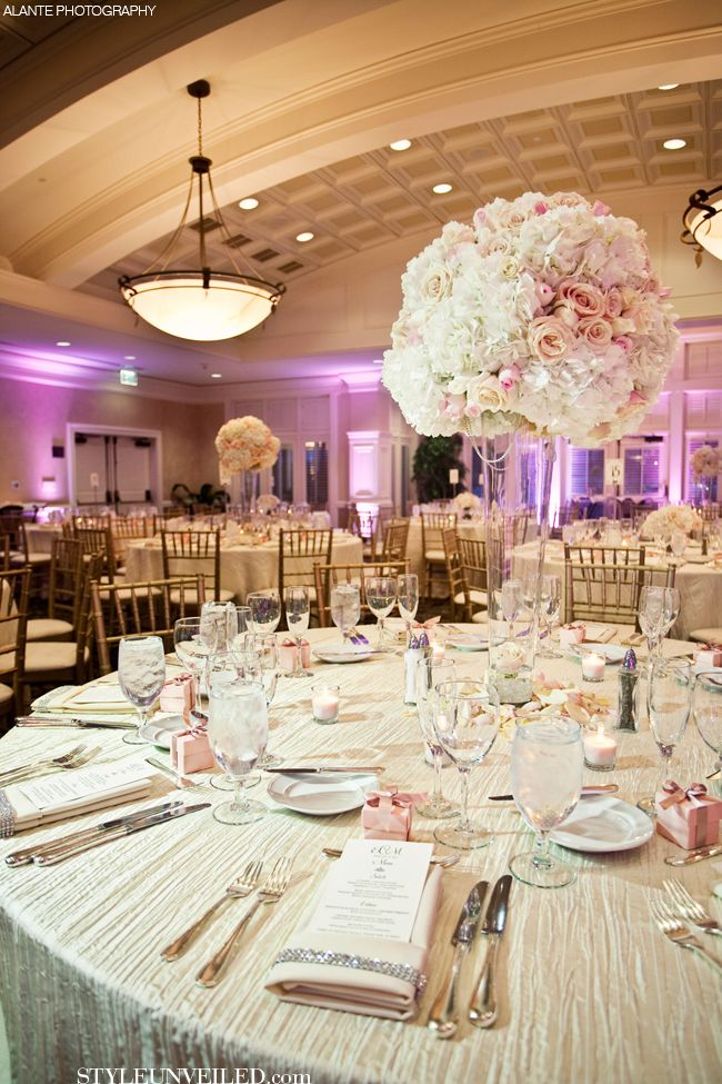Love the accent light in the background. Makes the centerpieces stand out more. Pink and White Wedding Tablescape with Sparkle / Alante Photography