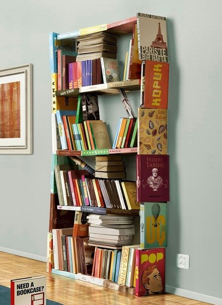 Maybe take book covers and nail/glue them over a wooden bookcase? Just a thought.