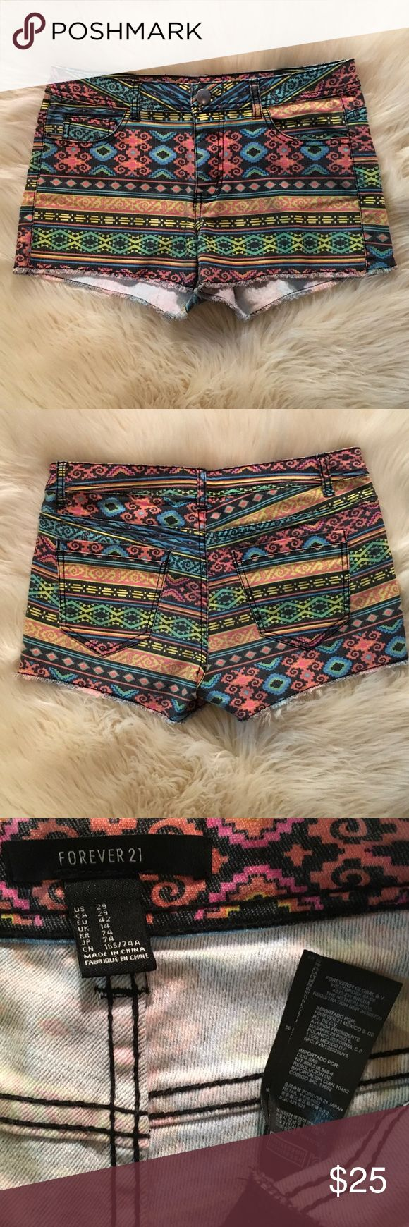 "Forever 21 Colorful Aztec Tribal Shorts Sz 29 NWOT Forever 21 Colorful Aztec Tribal Shorts. Raw Edge. Black stitching. Inseam 2.5"", Rise 9"" size 29, US 8 NWOT Forever 21 Shorts Jean Shorts"