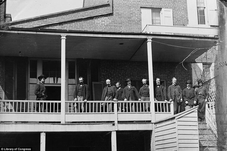 DC's backbone: Officers and clerks on a porch at Signal Corps headquarters in May of 1865