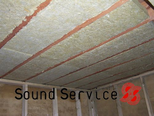 Acoustic mineral wool sound absorption installed between ceiling joists to soundproof a ceiling