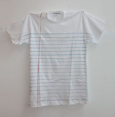 These shirts (are) rule(d). The white background, evenly-spaced horizontal blue lines and the red margin divider are so recognizable it would be hard not to walk up and write on someone wearing these.