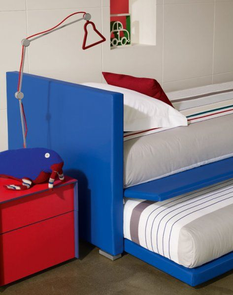 "It's the weekend! Time for a sleepover! [""Biss"" by Flou. Trundle Bed with removable cover. Design by Pinuccio Borgonovo. Various fabric options available] #Bedroom #InteriorDesign #HomeDecor #Design #Arredamento #Furnishings #red #blue"