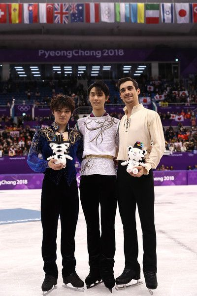 (L-R) Silver medal winner Shoma Uno of Japan, gold medal winner Yuzuru Hanyu of Japan and bronze medal winner Javier Fernandez of Spain celebrate during the victory ceremony for the Men's Single Free Program on day eight of the PyeongChang 2018 Winter Olympic Games  at Gangneung Ice Arena on February 17, 2018 in Gangneung, South Korea.