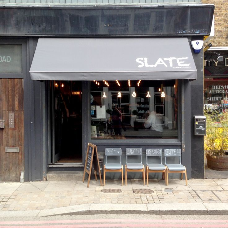 Plumen bulbs show their five faces in the window of Slate Coffee Shop on Curtian Road, London - http://www.slatecoffeelondon.co.uk/