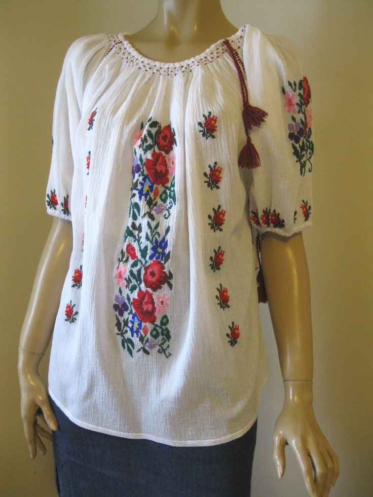 Charming handmade Romanian peasant  blouse, hand embroidered with multicolored cotton and acrylic thread on finest gauze cotton.  Available at www.greatblouses.com