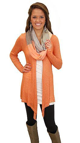 This site has the long tanks and the cardi to go with the leggings