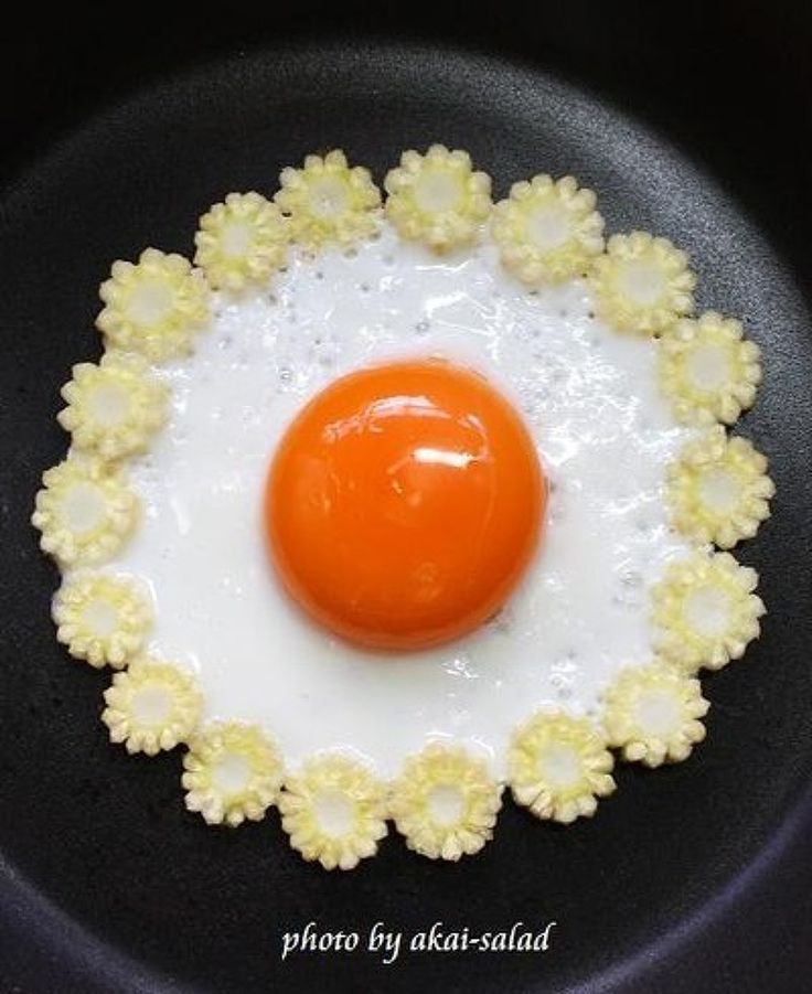Fried egg with lacey mini-sweetcorn sliced edging.