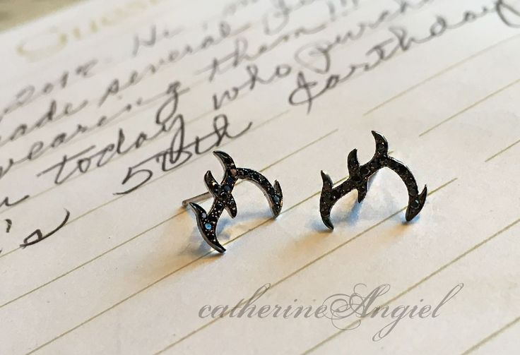 "Black diamond, tattoo inspired ""F"" stud earrings hand crafted by the artist, Catherine Angiel"