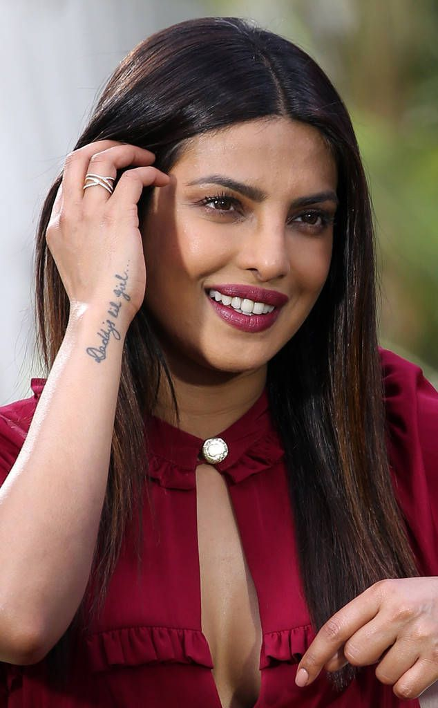 Priyanka Chopra from The Big Picture: Today's Hot Photos  The stunning actress shows off her Daddy's lil girl tattoo while doing a Press Interview for Baywatch in Miami.