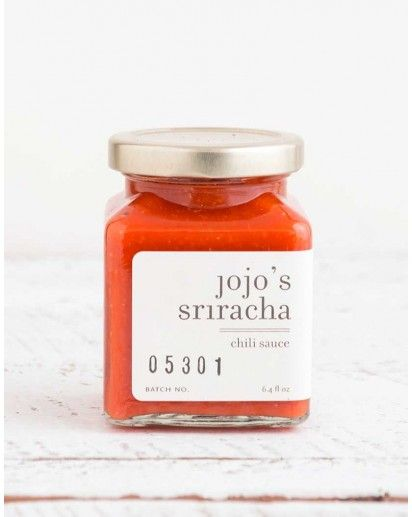 JOJO'S SRIRACHA CHILI SAUCE. Jolene Collins decided to take a month-long break from refined sugars. During that month she did most of her own cooking and created refined sugar-free versions of her favorite foods. She started with sriracha and voila! Jojo's Sriracha Chili Sauce was born. $14.00