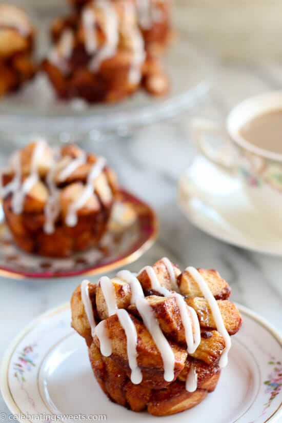 Cinnamon Roll Monkey Bread Muffins - Use cinnamon rolls for this tasty twist on monkey bread. Sweet, soft, filled with cinnamon, and topped with cream cheese icing.