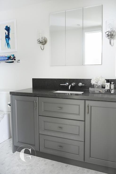 Fabulous bathroom features a dark gray extra wide single ... on Bathroom Ideas With Black Granite Countertops  id=21351
