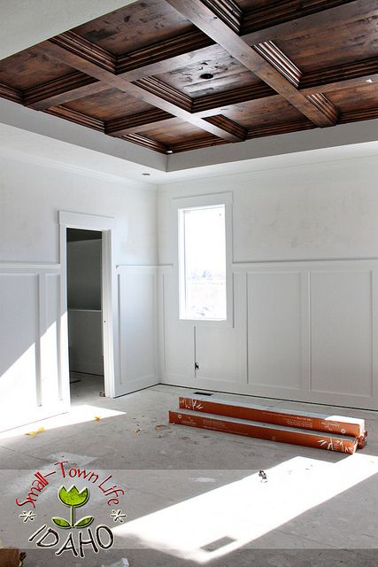 exactly the wood trim I'm looking for in 1 pic: window and door casings, wainscotting and ceiling. Except white beams and trim to a drywall ceiling....unles the wood doesn't blow the budget!!!!!!