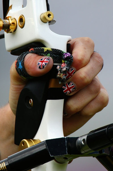 A detail view of the hand and nail varnish of Naomi Folkard of Great Britain in action during the Women's Team Archery Eliminations match between Great Britain and Russia at Lord's Cricket Ground Photograph: Paul Gilham/Getty Images