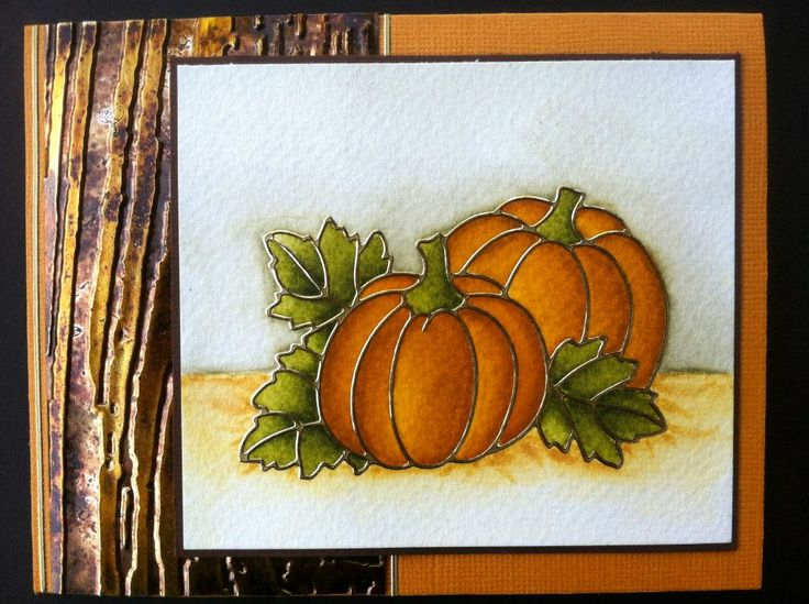 New pumpkin peel-off colored with Distress Markers. The background of this card is a piece of the Bronze Shimmer Sheetz. Used the blending solution (this only works on one side of the Bronze Shimmer Sheetz), then embossed it and at the end I rubbed over it with the Saddle Brown StazOn. Put it all together using our 5mm Be Creative Tape.