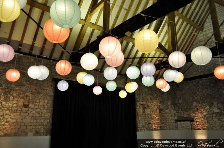 Chic mixed pastel lanterns with our incredible disco option for the evening - the lanterns transform to colour change mode at the touch of a button! #weddinglighting #oakwoodevents #monksbarn