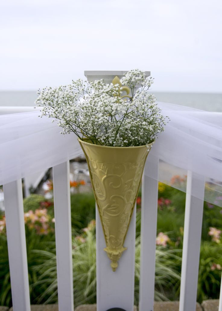 //Everett Wedding 7.18.14// Tulle along deck railing, with flower holders from Garden Ridge spray painted yellow to match, filled with simple baby's breath