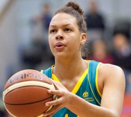 """We expect pro basketball players to be tall and Liz Cambage lives up to those expectations. The 6'8"""" Australian is the tallest active planer in the WNBA. She plays center for the Tulsa Shock and is also a member of the Australian women's national basketball team."""