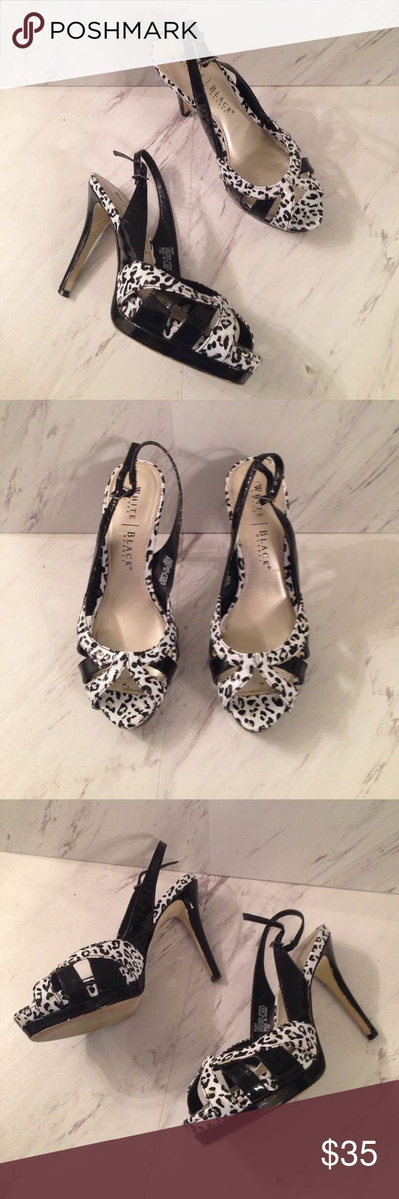 "White House Black Market Leopard Strappy Heels Black and white snow leopard pattern heels. Strappy at the toe and the ankle. Good condition Sandals. Size 7.5 M, leather upper with an approx 4"" heel and some marks on the heels and around the base. Please view photos and ask questions. White House Black Market Shoes Heels"
