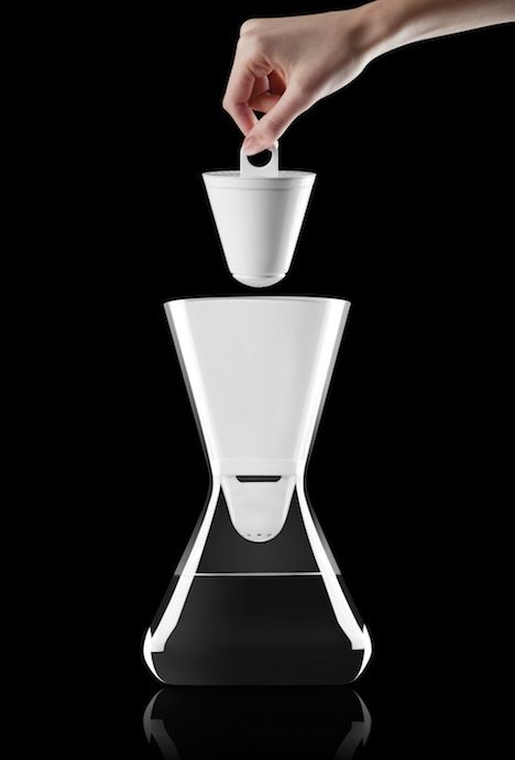 Soma, a glass carafe and 100% compostable water filter. Designed by David Beeman.