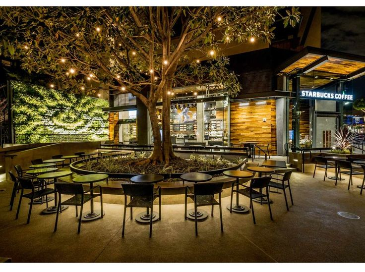Starbucks in Anaheim, CA - builds with an expansive floor-to-ceiling glass walls and a generous patio space.
