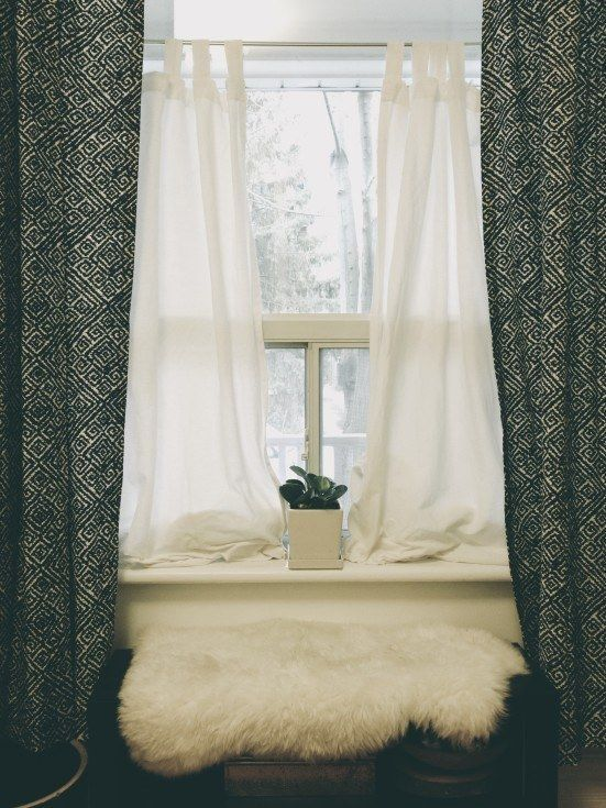 Easily install an inexpensive curtain with fabric and a tension rod.