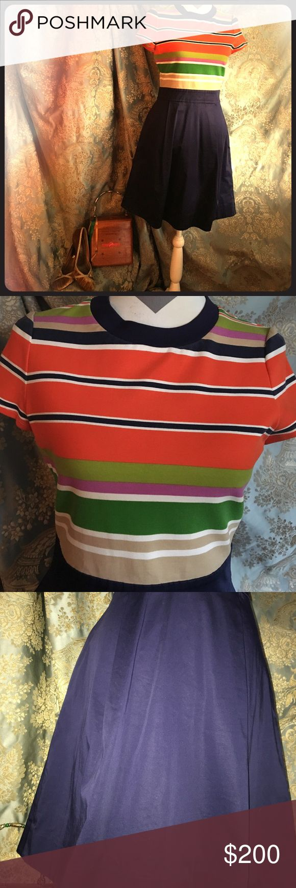 Kate Spade Dress Size 6 NWOT stylish Kaye Spade dress in a size 6. Skirt portion is heavy-weight navy cotton 2 lg. pleats front/back. Top portion is heavy-weight but soft stretch knit in orange/navy/tan/cream/med & lt. green/lavender stripes. Decorative brass zipper w/pull; hook & eye closure at neck. Cigar box purse and gold velvet shoes sold separately. Kate Spade Dresses
