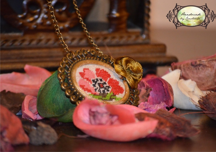 Adorable stitched necklace with floral design. The pendant is embroidered on cotton fabric with a lot of playful colors.