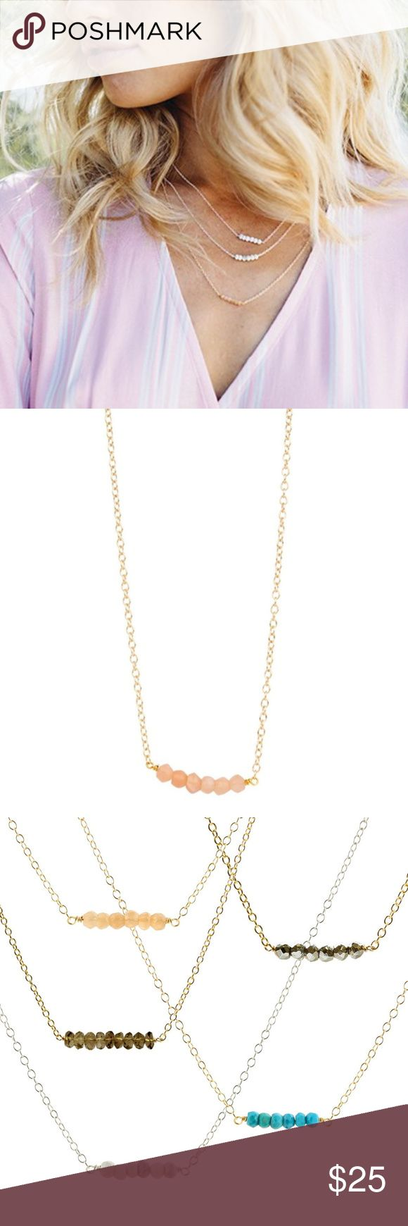 """Kris Nations Mystic Bar Moonstone Peach Necklace This necklace is a gem (literally)! The stones are hand-cut by craftsmen in India and each one has an attribute that helps you live every day with positive intentions. 18K Gold Overlay. Adjustable 16-18"""". You are getting the PEACH necklace ONLY. Shown styled! Kris Nations Jewelry Necklaces"""