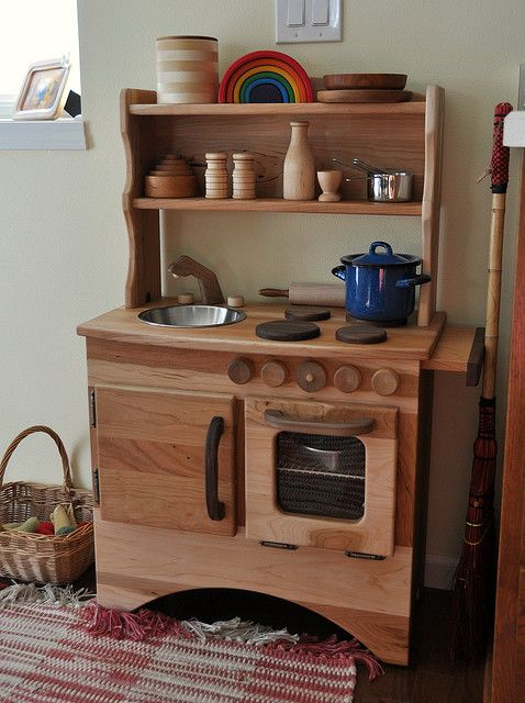 Time for a smaller kitchen? Unpainted wood Waldorf kitchen.