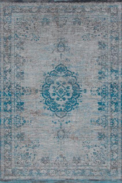 Vintage Teppich Grau Blau - Hamburg. Dieser Vintage Teppich schmückt jedes Heim. Die Farbe ist neutral und lässt sich so mit jedem Möbelstück kombinieren.