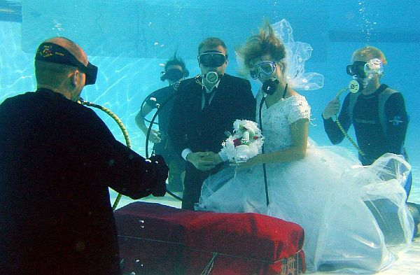 DESTINATION WEDDING UNDER WATER Scuba weddings are safe, fun and exciting. Your underwater marriage will be a memorable experience--uniquely yours. The sea embraces you both. Underneath the waves there are no distractions, you hear each other breaths and the beating of your hearts . Getting married underwater is a romantic and unique way to start your life together. Under the waves, silence embraces you bot