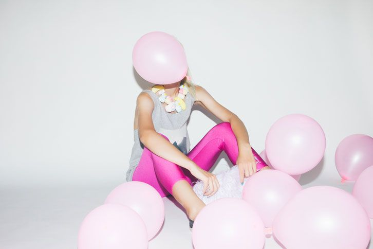 pink 80s leggings with grey oversized tshirt and Ursula clear clutch bag