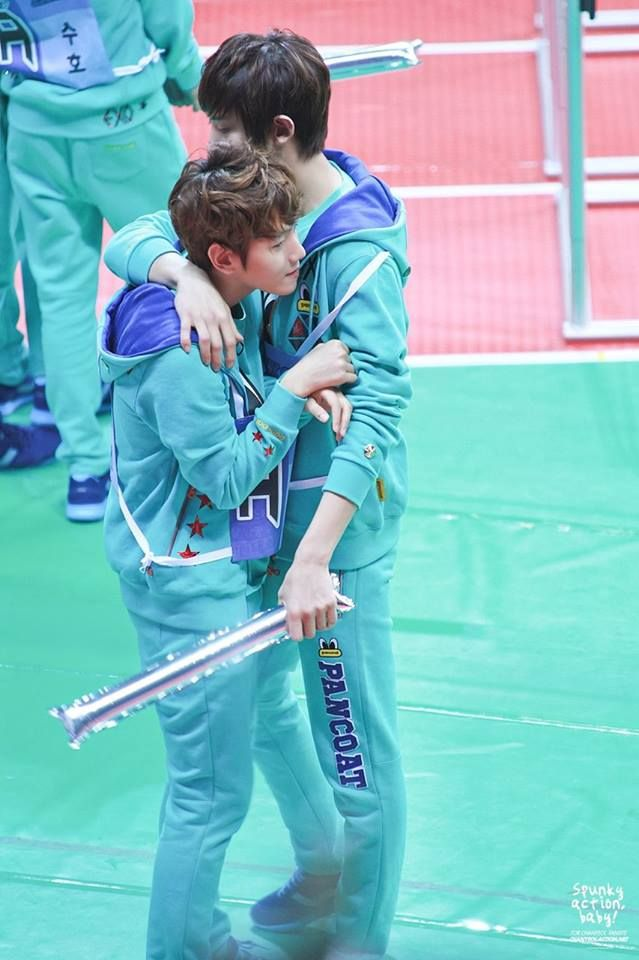 Chanyeol wrapping a cute little rat in his arms. xD