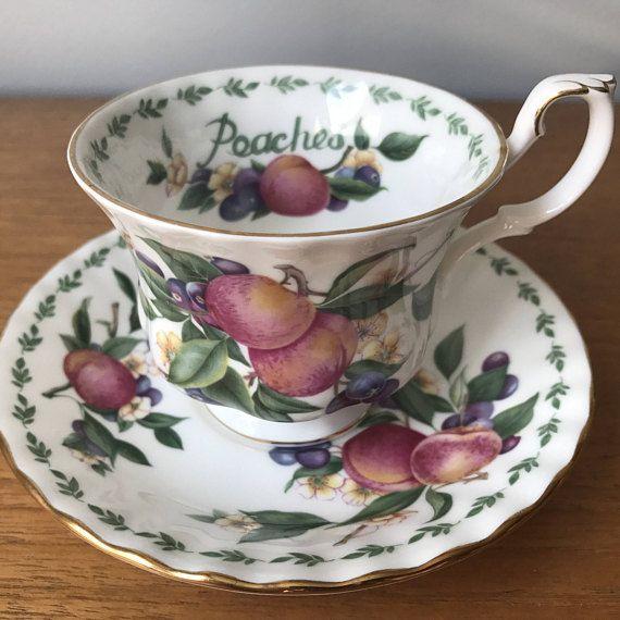 Royal Albert Vintage Teacup Pattern: Peaches Covent Garden Fruit Series This is a lovely teacup and saucer in the montrose shape. This set has orange and pink peaches, white blossom flowers and purple berries with lots of green leaves. There is a little green leaf garland around the edges