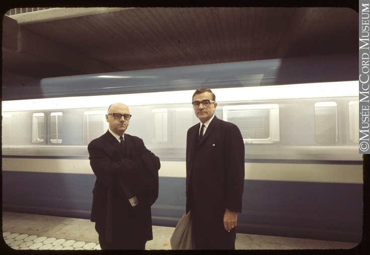 Le maire Jean Drapeau et Lucien Saulnier lors du passage inaugural du métro. 1966. // Mayor Jean Drapeau and Lucien Saulnier, as the first Metro train passes. 1966.